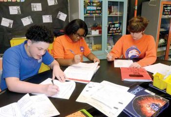 all 8th graders at Horizon Science Academy in Youngstown, study together by using their study guides for an upcoming science test